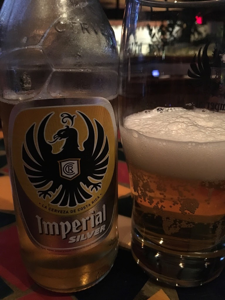 imperial silver beer bottle and glass