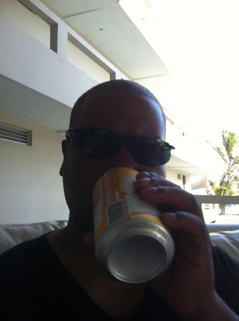 man drinking a can of beer in Isla Mujeres