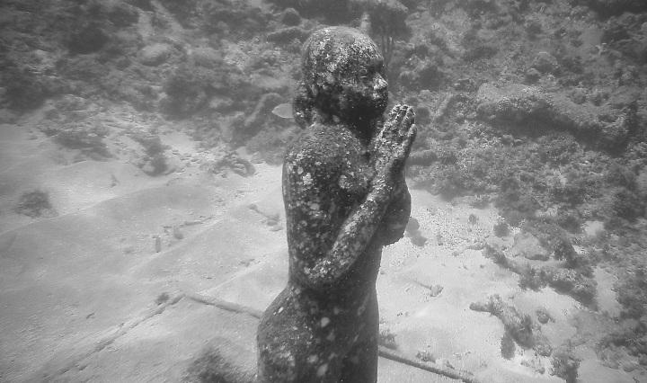 sculpture of woman praying