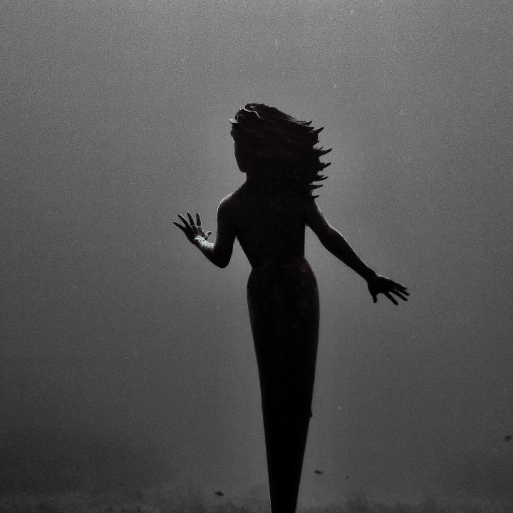 underwater mermaid statue in grand cayman